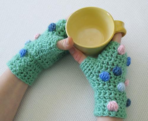 fingerless gloves and handmade clay mug